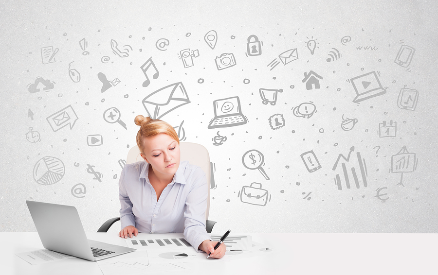 Business woman sitting at table with hand drawn media icons and